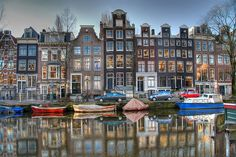 "These houses are amazing, and decent size yards behind them as well! Love the ""grachtenpanden"" in Amsterdam !!"
