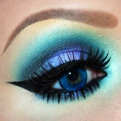 Teal and violet eye makeup by: brittanycouturexo