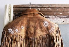 Gorgeous tan leather Western-style jacket, with painted white flowers and fringe...