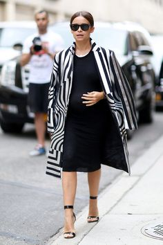 Miroslava Duma rocked the black and white trend with a bold, printed coat.  NYFW SS 2015