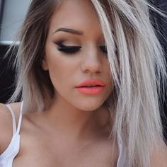 I love love love the hair, the make up, and oh!, that lip color!