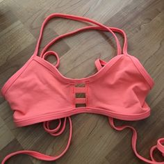 Jolyn tomcat swim top Size small. Neon salmon color. Cross back style. Like new, worn once! (*Also selling jolyn bottom! See page for post. Willing to sell top and bottom for $50) Jolyn Clothing Swim Bikinis