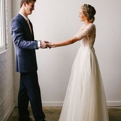 modest bridal gown with flowy skirt and elbow sleeves. photo by mandi nielsen