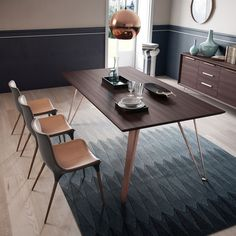 At nearly 80-inches long, the Grand Dining Table can happily accommodate an evening with the family. http://www.yliving.com/modloft-grand-dining-table.html