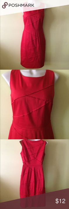 "Calvin Klein Dress Cute, form fitting red dress. Sleeveless with side zipper. Back kick pleat. Shell is 97% cotton and 3% spandex. Fully lined, 100% polyester. Size 10. 18.5"" across underarms, 15.5 at waist and 20"" at hips. Approximately 18"" from shoulder to waist and 23"" from waist to hem. Gently worn. Label says dry clean only, but I washed it in the gentle cycle and hung to dry and it came out beautifully. Calvin Klein Dresses"