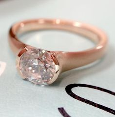 Half bezel solitaire engagement ring in rose gold by Sholdt