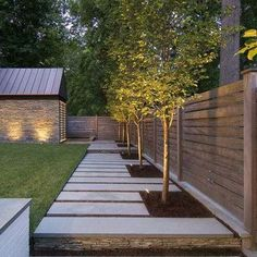 In backyard - Lined with Trees backyard on South side of property w/ Lighting to be added