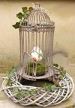 Birdcage in a wicker wreath