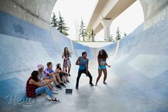 Teenagers dancing on ramp at skateboard park by Hero Images  on 500px