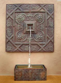 wall fountain. Just like this. I love the wall hung medallion and spigot.