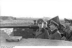Field Marshal Rommel and Lieutenant General Rupprecht (of Luftwaffe 16th Division) inspecting a forward artillery position, Dunkirk, France, 22 Dec 1943