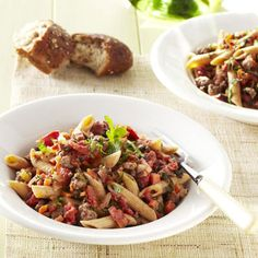 This classic pasta dish is made a little healthier by using lean beef and substituting whole-grain penne for regular pasta.
