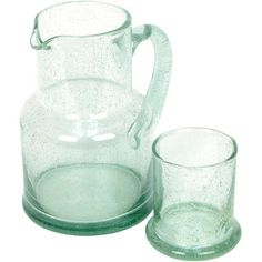 Recycled+glass+is+melted+down+and+finds+new+life+in+an+adorable+pitcher+and+glass+set+from+makers+in+Bolivia.+The+bubbles+aren't+just+cute,+their+variation+enhances+authenticity.+With+a+tumbler+that+doubles+as+the+pitcher's+lid,+this+set+is+an+ideal+way+to+keep+a+drink+of+cool+water+at+your+bedside+table.
