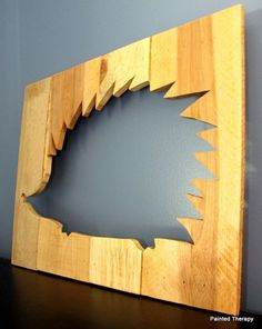 Cute hedgehog silhouette wall art from reclaimed wood.