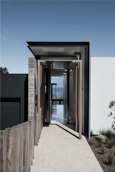 Once the front door opens, one can see all the way through to the sea. Tagged: Doors, Metal, Exterior, and Swing Door Type. Photo 6 of 20 in A Superb Australian Home Angles For Seaside Views. Browse inspirational photos of modern doors and entryways. Architecture Life, Architecture Details, Minimal Architecture, Australian Architecture, Luxury Boat, Storey Homes, Passive House, Modern Coastal, Coastal Decor