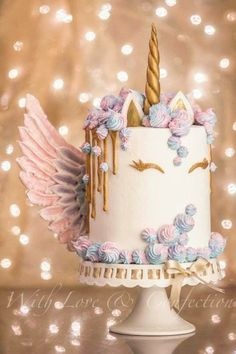 Unicorn Drip Cake with Meringue Wings - Cake by Veronica Arthur of With Love & Confection. My version of the ever so popular Unicorn cake with meringue kisses and MERINGUE WINGS! White chocolate drip painted in gold luster. Cake is 4 layers of unicorn swi Unicorne Cake, Cake Art, Eat Cake, Cupcake Cakes, Pretty Cakes, Cute Cakes, Beautiful Cakes, Amazing Cakes, Chocolate Drip