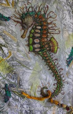 Beautiful material...one of a kind machine and hand stitched sea horses.