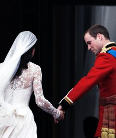 sweet picture of Prince William reaching for Kate's hand .. Royal Wedding Day