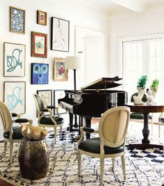 A piano is the best centerpiece for a room. Love the art and its arrangement. Love how stunning, sleek yet homey and comfortable this space is!
