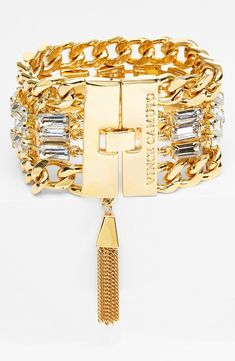 Gold bracelet with a glam punk edge.