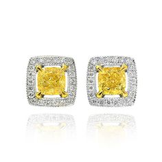Floating Fancy Yellow halo earring studs. Mounted in 18K white and yellow gold the earrings are set with GIA certified Fancy Yellow cushion diamonds 0.85Ct TW, with gap between the centre diamonds and surrounding halos. The halos are set with 0.15Ct TW collection white round brilliant diamonds
