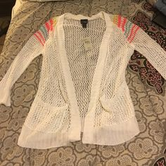See through cardigan ! Never worn with tags ! Has small pockets Buckle Tops