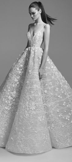"""Embellished Gown""""featuresan A-Line silhouette with a low v neckline, fitted bodice, spaghetti straps and gathered skirt"""