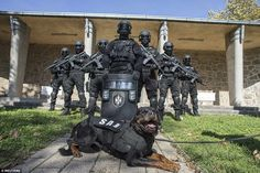 Power: Serbian police officers from the Special Anti-Terrorist Unit pose for a picture in their base outside the capital city Belgrade