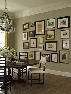 Good gallery wall. Mixed frames, pictures hang low on the wall.