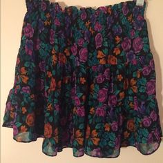"Flouncy Forever 21 Skirt Cute floral pattern. 3 tiers of little ruffles. Definitely ""mini"" Forever 21 Skirts"