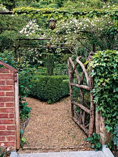 Pergolas, arches, and gates fashioned from branches give this Atlanta garden the appeal of a fairy wonderland. (Photo: Roger Foley)