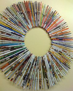 Magazine pages are rolled around pencils to take shape.  How awesome is this!!