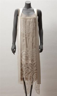 Evening dress, by Callot Soeurs, c. 1927-29, at the Gemeentemuseum Den Haag. Dress with petticoat of beige tulle with embroidery of white beads. Cream silk satin ribbon hanging around the neck.