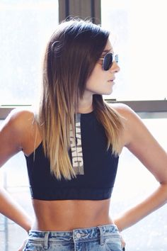 @weworewhat keeps it cool in a black & white zip-up sports bra from the Alexander Wang x H&M collection. | H&M OOTD