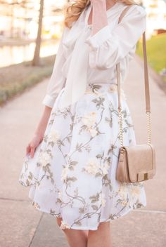 Neutrals are perfect for spring. This cream tie front blouse, embellished floral skirt and nude bag are the perfect combination.