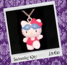 "BROKENDOLL 'SWIMMING KITTY' NECKLACE. £8.00 Look Fabulous with this iconic Japanese Kawaii character 'Hello Kitty'. She measures approx 3.5cm x 2cm and is on a 18"" silver plated chain."