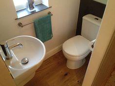 Understairs Powder Room Installation by UK Bathroom Guru. Understairs Powder Room Installation by UK Small Downstairs Toilet, Small Toilet Room, Downstairs Cloakroom, Small Bathroom, Bathrooms, Understairs Toilet, Understairs Ideas, Corner Toilet, Bathroom Under Stairs