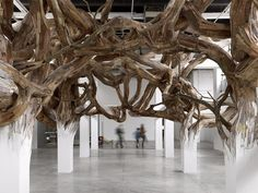 Henrique Oliveira - Architectural Columns at the Palais de Tokyo Explode into Organic Forms wood installation architecture Land Art, Instalation Art, Architectural Columns, William Blake, Repurposed Wood, Recycled Wood, Expositions, Deco Design, Wood Design
