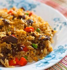 Beef_fried_rice. 2T soy sauce 1/2 t sugar 1 T oil 2 eggs beaten 1/2 lb ground beef 1 medium carrot finely chopped 1 celery rib finely chopped 1 scallion chopped 1 t fresh ginger minced 1 clove garlic minced 2 c cooked rice cold Heat oil over medium high heat. Cook eggs until set. Set aside Cook beef, next 3 ingredients over medium heat 3 min until browned. Stir in ginger, garlic. Discard excess fat. Increase heat to high, add rice. Stir in seasonings & eggs, 30 seconds
