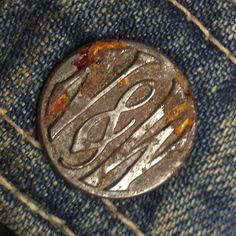 aged jeans button