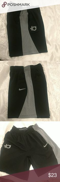 Kd  Nike shorts Black and grey never worn bought online too small for my older son adult large but I think runs small like medium. Nike Shorts