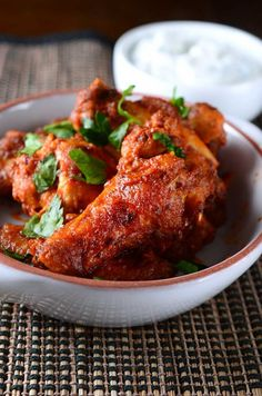 Chicken wings baked to perfection and tossed in a harissa butter sauce.
