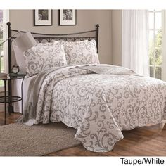 @Overstock - Loreal 3-piece Quilt Set - Add a whimsical touch to your bedroom decor with the Loreal floral quilt set. This contemporary quilt set includes one quilt and two quilted pillow shams.  http://www.overstock.com/Bedding-Bath/Loreal-3-piece-Quilt-Set/8973937/product.html?CID=214117 $53.99