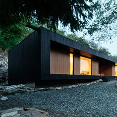 Woodland retreat by Béres Architects nestles up against a jagged rock face - dezeen