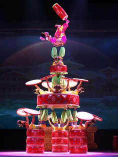 Acrobatic performance in Beijing and the rest of China is highly addictive entertainment. The shows are accompanied with musical performances, dance and a wide variety of unbelievable feats. Performed with unique skill, perfected since childhood. Here the Beijing Acrobatic Troupe is performing it's colourful acrobatic show, in one of the most highlighted entertainment venues in Beijing at Chaoyang Theatre. Popular with both travellers and the locals!