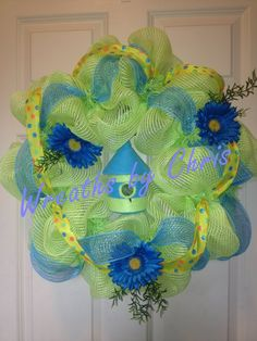 Summer is coming with a bright blue and lime wreath that features a birdhouse, Gerbera daisies and two different ribbons!