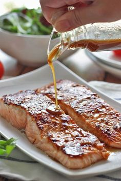 Swap coconut aminos for soy sauce. Quick and easy honey garlic salmon baked and ready in under 30 minutes. With a sweet and savory marinade and sauce of garlic, ginger, honey and soy sauce. Fish Recipes, Seafood Recipes, Cooking Recipes, Baked Salmon Recipes, Dinner Recipes, I Love Food, Good Food, Yummy Food, Fish Dishes