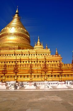 The Shwedagon Pagoda is completely covered with gold plating and enshrines the sacred Buddha relics, including Gautama's.
