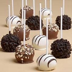 Fancy cake pops topped with chocolate chips, almonds, and drizzled chocolate (Shari's Berries). Not a recipe--just like the way they're decorated!