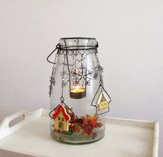 Inspiration: fold wire into a hanger that suspends a tea light holder into a container. Wire Ornaments, Wire Tutorials, Wire Crafts, Bottles And Jars, Recycled Art, Wire Art, Tea Light Holder, Tea Lights, Candle Holders